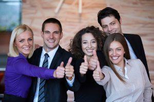 Young new financial advisor coaching team celebrating
